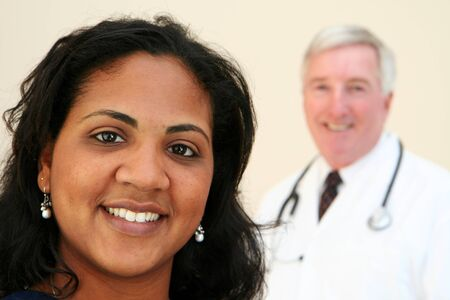 Caucasian Doctor with minority Nurse photo