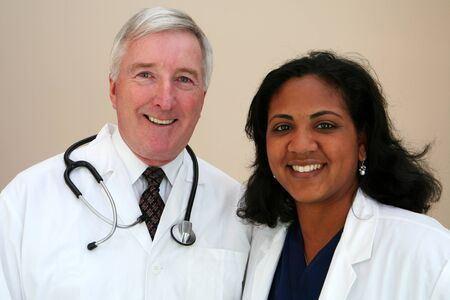 Caucasian Doctor with minority Nurse Stock Photo - 13299549