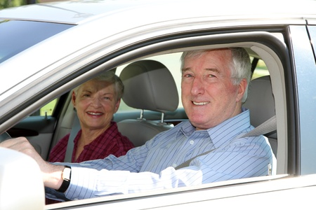 woman driving car: Senior citizen couple sitting in their car Stock Photo