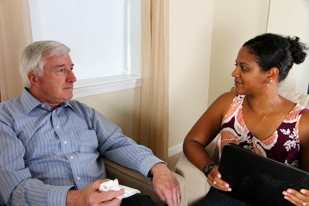 Senior Man in Counseling Session with Woman Stock Photo - 13293455