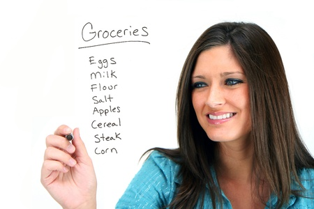 Mother writing her grocery list Stock Photo - 13314930