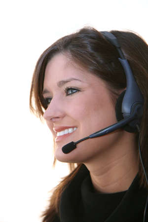 A young woman against a white background talking on a headset photo