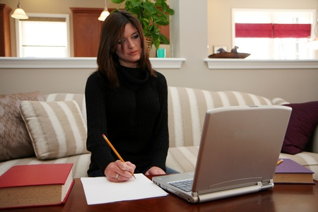 Young woman on her computer and studying