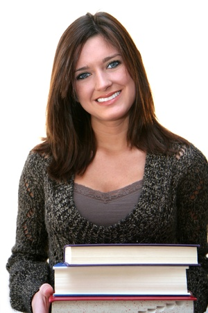 A young student with books ready for class photo