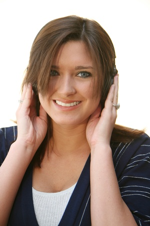 A young woman listening to headphones photo
