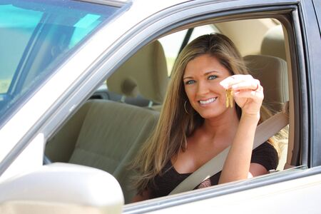 Woman Sitting In Car Holding Set of Keys photo