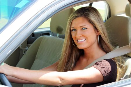 Woman Sitting In Car Getting Ready To Drive photo