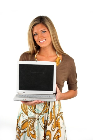 Happy young woman holding a computer for advertisement photo