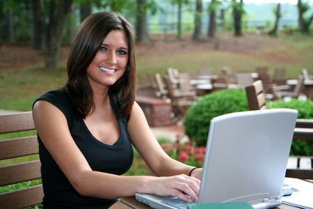 laptop outside: Young woman on her computer and studying