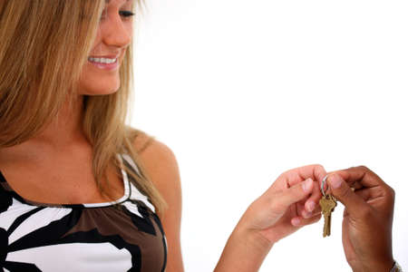 Woman Handing A Set Of Keys To Another Woman photo