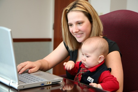 A mother with her son on the laptop computer photo
