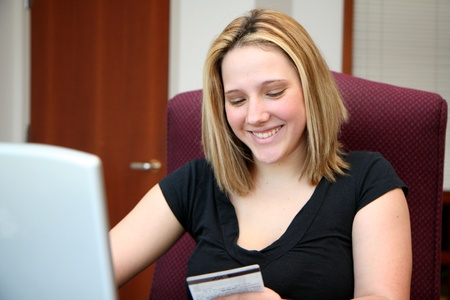 Woman shopping on the computer over the internet Stock Photo - 13316889