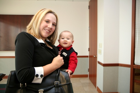 working woman: A mother with her son at her job Stock Photo
