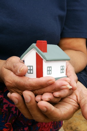 homeowners: Family together outside their home