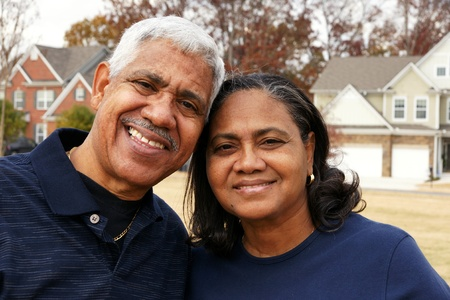 minority couple: Family together outside their home