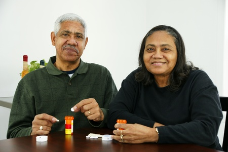 Seniors taking pills Stock Photo