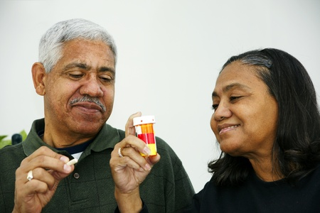 Seniors taking pills Stock Photo