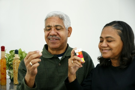 Seniors taking pills photo