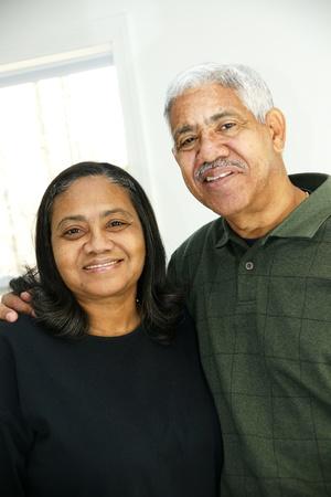 interracial marriage: Senior Couple in their home Stock Photo