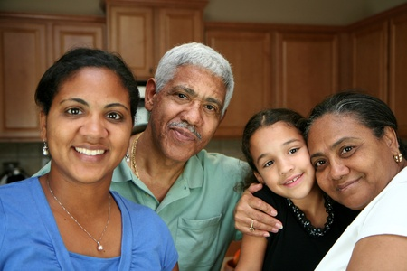 Minority family standing in their kitchen photo