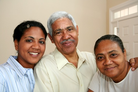 Minority family in their new home Stock Photo - 13414289