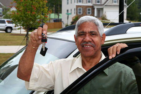 dealership: Minority man who just bought a new car Stock Photo