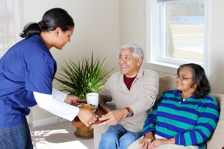 seniors homes: Home health care worker and an elderly couple