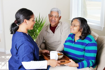 Home health care worker and an elderly couple Stock Photo - 13413981