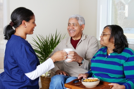 Home health care worker and an elderly couple Stock Photo - 13413982