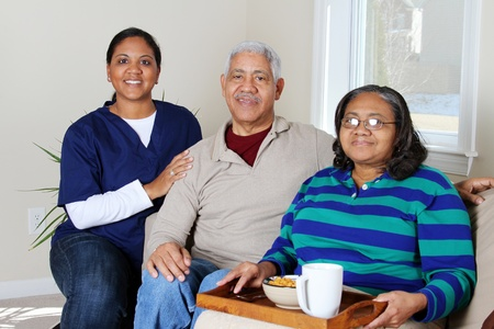 Home health care worker and an elderly couple Stock Photo - 13413980