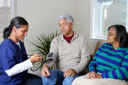 home care nurse: Home health care worker and an elderly couple