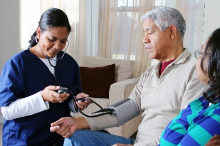 checkup: Home health care worker and an elderly couple