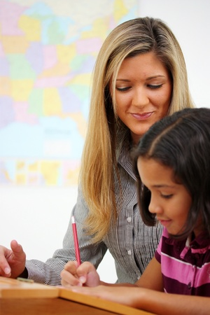 Teacher and Student In A Classroom At School photo