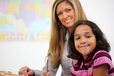 blonde minority: Teacher and Student In A Classroom At School Stock Photo
