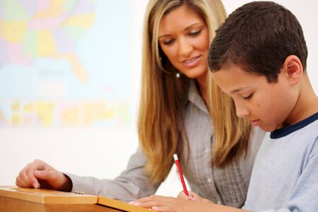 Teacher and Student In A Classroom At School Stock Photo - 13408536