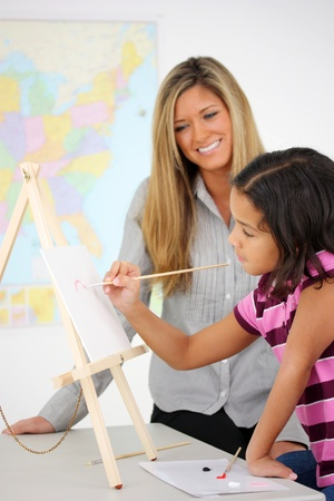 blonde minority: Teacher and Art Student In A Classroom At School