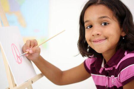 hispanic students: Art Student In A Classroom At School