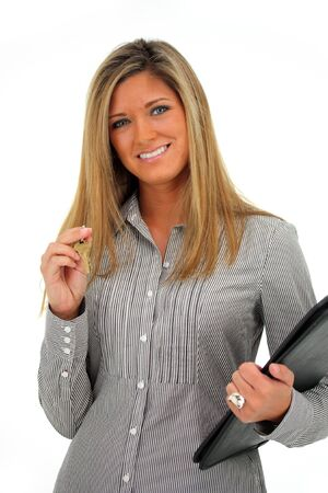Woman Holding a Set of Keys with a White Background Archivio Fotografico