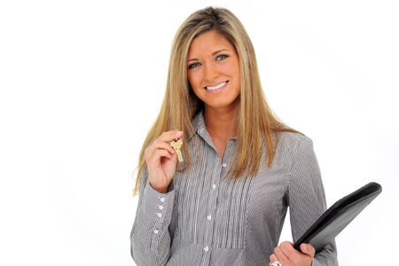 Woman Holding a Set of Keys with a White Background photo