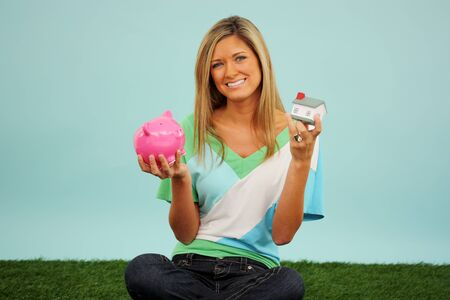 Woman Sitting Outside In The Grass With Bank Stock Photo