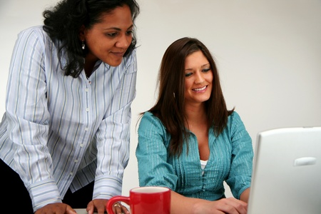 Two women at the computer Stock Photo - 13408965