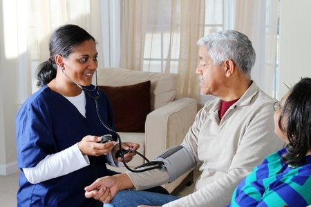 Home health care worker and an elderly couple Stock Photo - 13398893