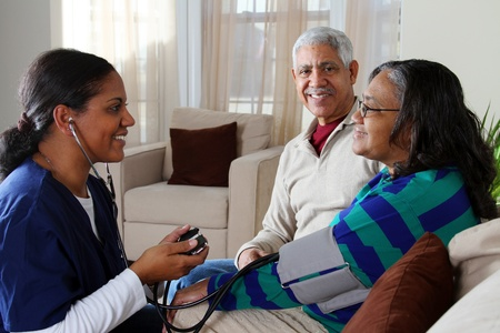Home health care worker and an elderly couple Stock Photo - 13398943