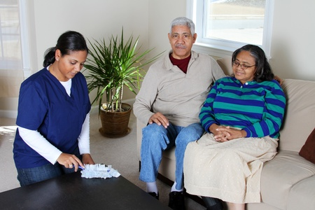 Home health care worker and an elderly couple Stock Photo - 13398857