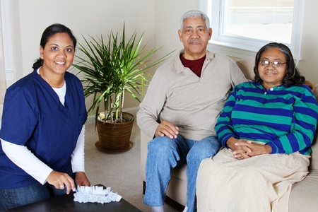 health care worker: Home health care worker and an elderly couple