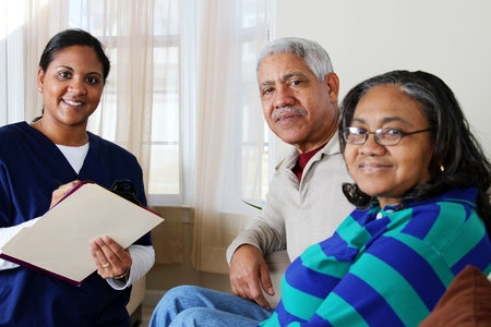 helping people: Home health care worker and an elderly couple