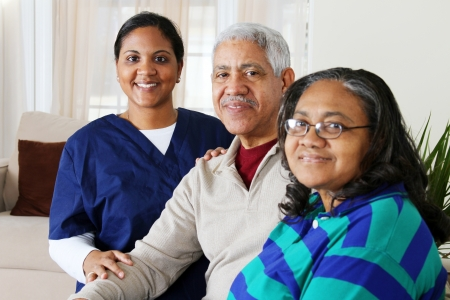 care at home: Home health care worker and an elderly couple