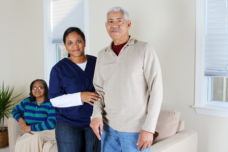 caregiver: Home health care worker and an elderly couple