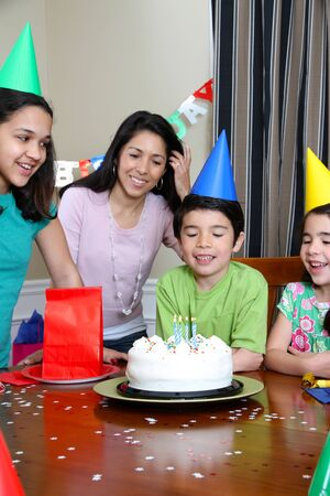 Group enjoying a birthday party for child Stock Photo - 13398963