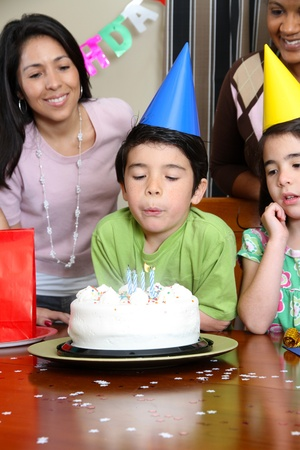 Group enjoying a birthday party for child photo